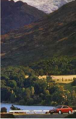 Extract (bottom part) from unidentified car ad with 'face' on mountainside.