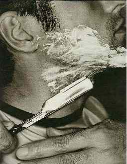 Jim Beam ad with open blade, cut-throat, razor.