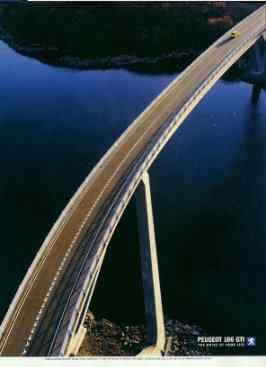Click for a larger, floating, image. Peugeot ad with 'face' under the top end of the bridge.
