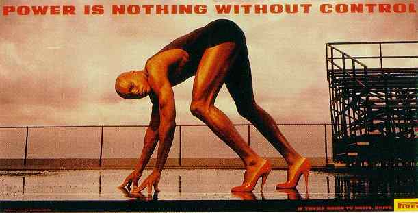 Click for a larger, floating, image. Pirelli ad with Carl Lewis in red, high heel, shoes.