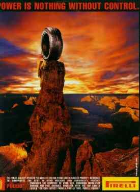 Pirelli tyre ad featuring a tyre on top of a column of rock.