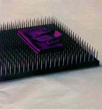 Click for a larger, floating, image. Silk Cut ad with purple bed of nails.